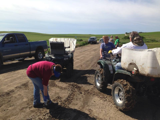 2014-06-24 FCUCC crew walks a field near Wakefield. They got wood and metal and mud 062414